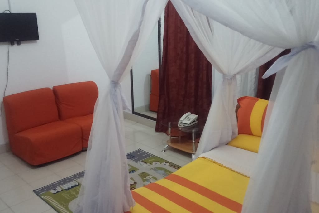 double bedroom with flatscreen Tv and cable channels