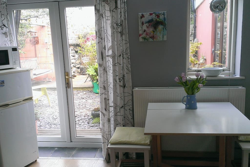Dining table and doors to garden.