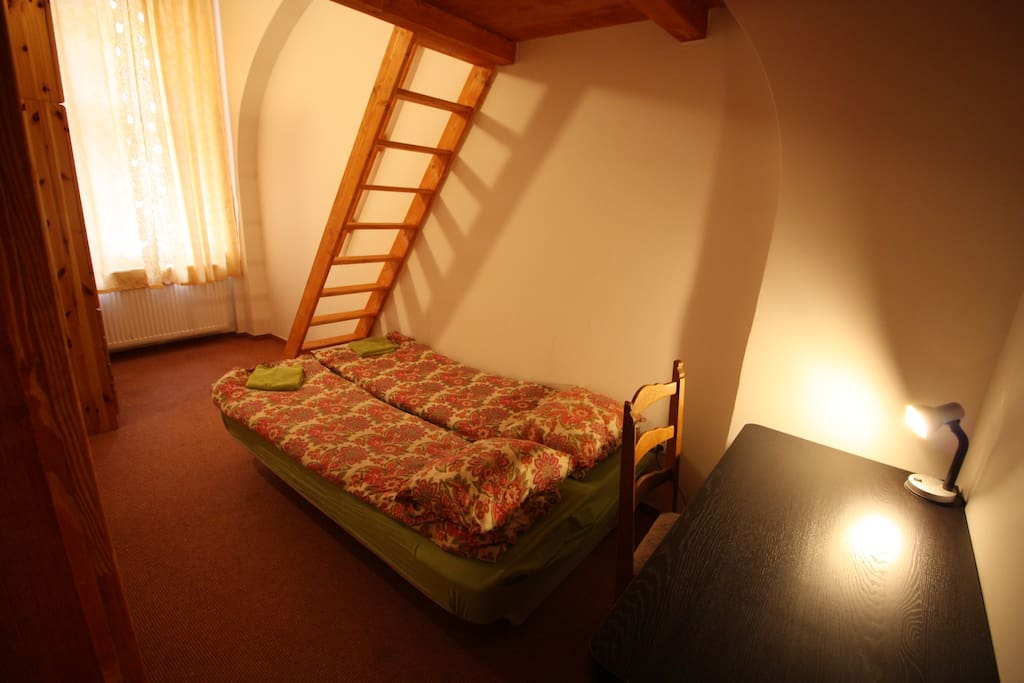 YOUR BEDROOM A arranged  for 4 persons, writing desk , wardrobe