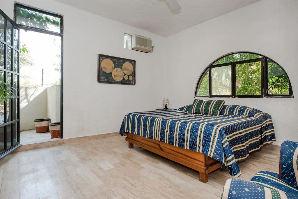 Large King bedroom with NEW large ensuite bath,  4 Windows overlooking pool and trees... air conditioned.