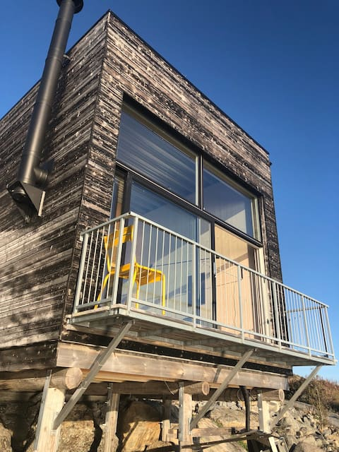 Small architect-designed house right by the sea