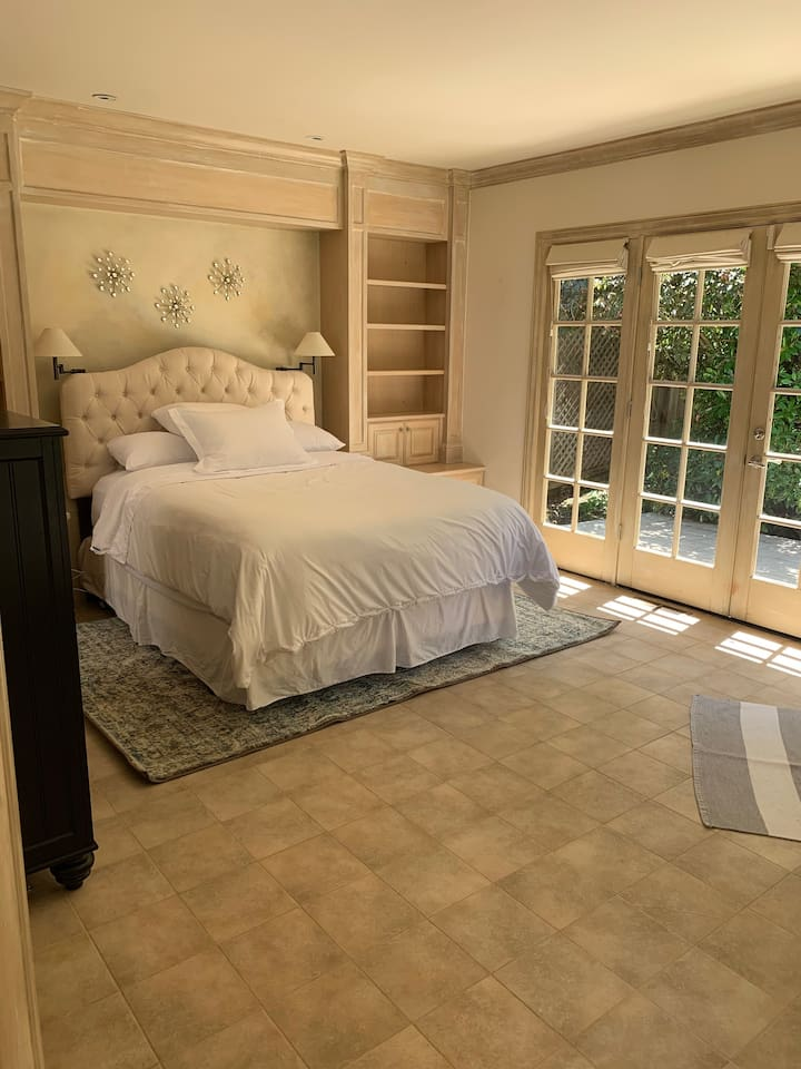 Large Bedroom with queen bed. Very soft sheets and very comfortable mattress.