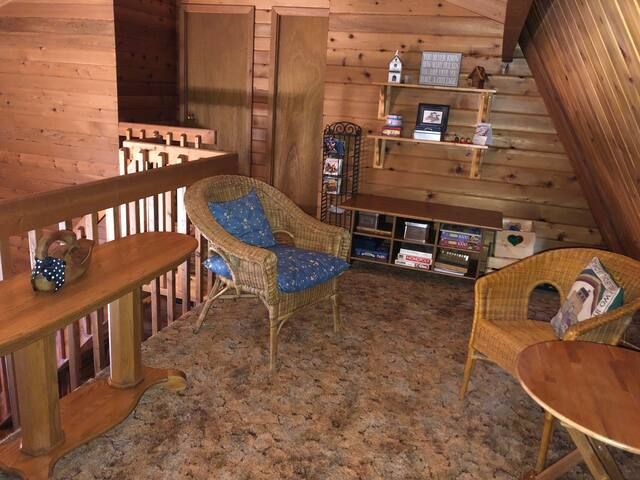 Loft area for reading playing games or 2 to sleep on futon double bed .