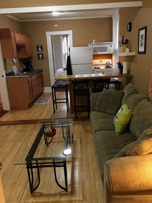 Living room area with pull out sofa bed, coffee tables, TV, wifi, DVD player and DVDs, games, and books! Great for entertaining or a game night in!