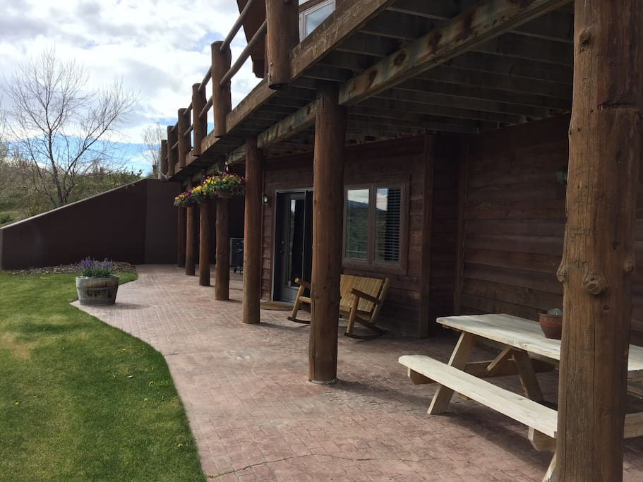 Private patio with grill and picnic table to enjoy outdoor meals together.
