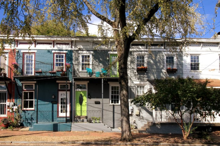 Look for the green door in this Classic series of Richmond row houses dating from the 1870's recorded in the National Register of Historic Places.