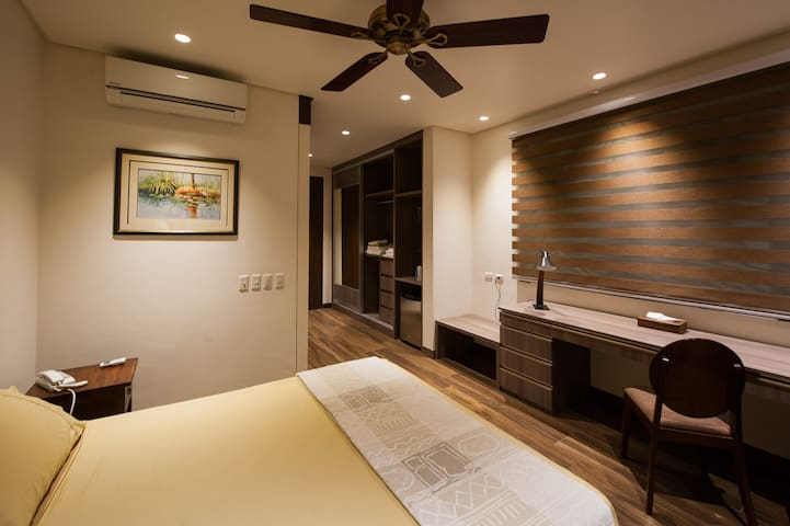 Inside the Sunset Room looking towards the closet and main entrance.