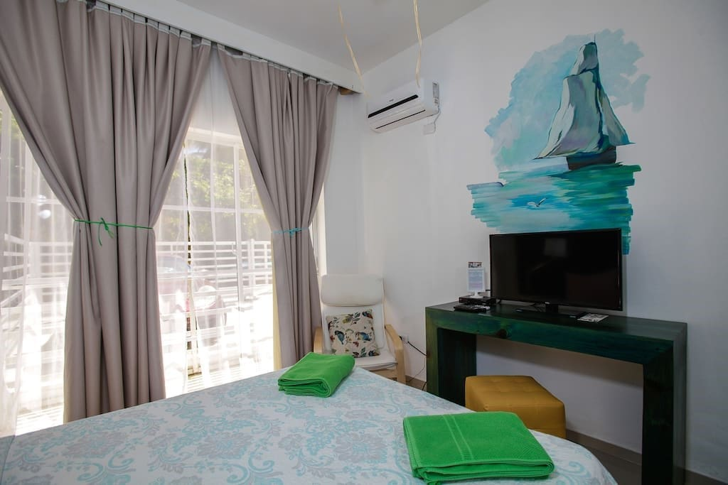 A very comfortable bed, soft pillows, sleep here like a baby, a little fridge and an electrician kettle are in your room. Art in every detail of the apartment, you'll love it