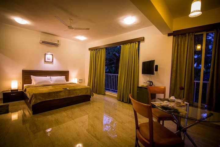 LUXURY ROOMS  WITH MINI BALCONIES ARE  LARGE ROOMS  AND OUR BEST SELLING ROOMS. BOASTING OF CEILING TO FLOOR WINDOWS /DINNING TABLE /FRIDGE /AC/32'LED/LED LIGHTING /WIFI/KETTLE AND ATTACHED BATHROOMS
