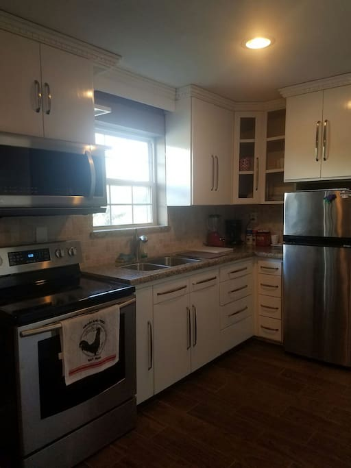Very nice large kitchen with granite countertops and stainless steel appliances