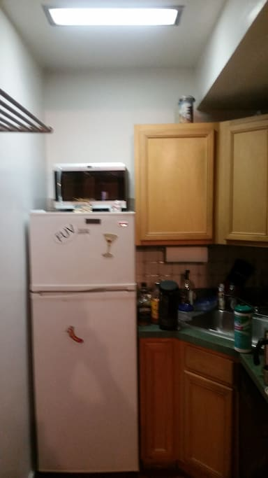 A kitchen! With a refrigerator and everything.