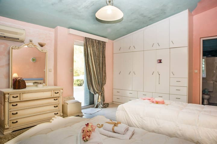 The 3rd bedroom with one double bed and one single bed with it's own private bath