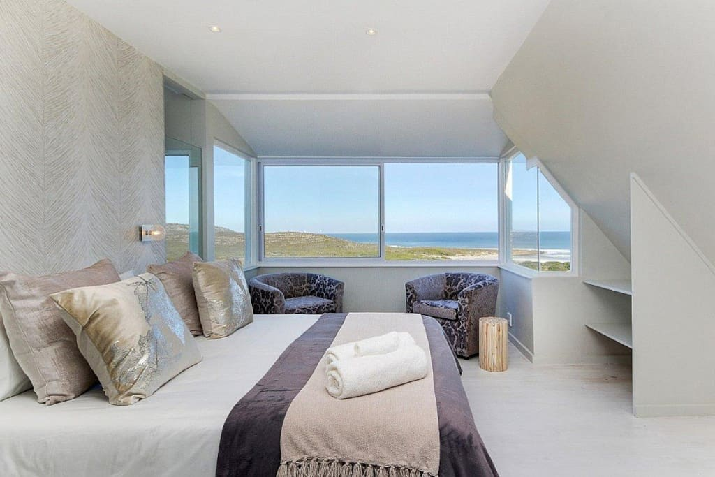 Master bedroom with extraordinary uninterrupted view of beach, sea and horizon - truly a place to relax