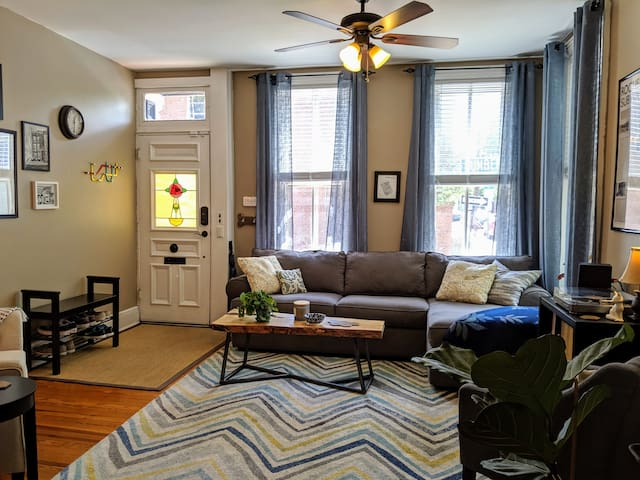 Living Room: couches, coat hooks, shoe bench.