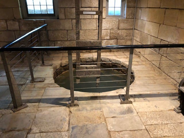 The well found in the original kitchens located under the inn
