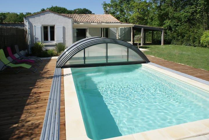 Villa vue boisée piscine chauffée Château d'Oléron
