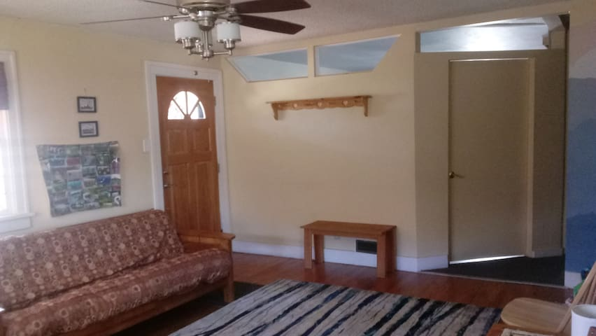 The front entrance with master bedroom door