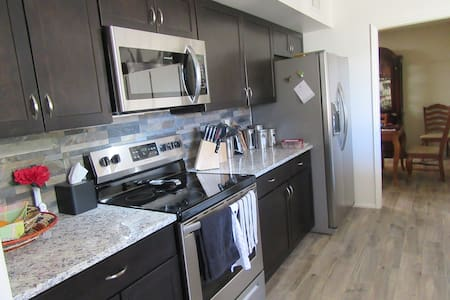Fully furnished duplex with large front patio.