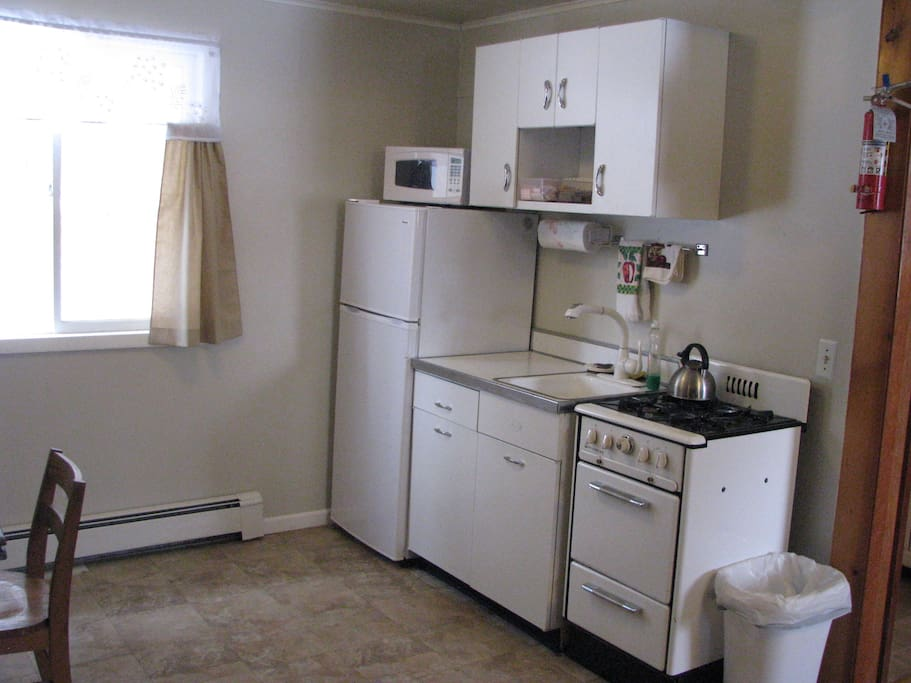Small retro style kitchen with microwave, coffee maker and toaster for you to use. Coffee and Tea are provided