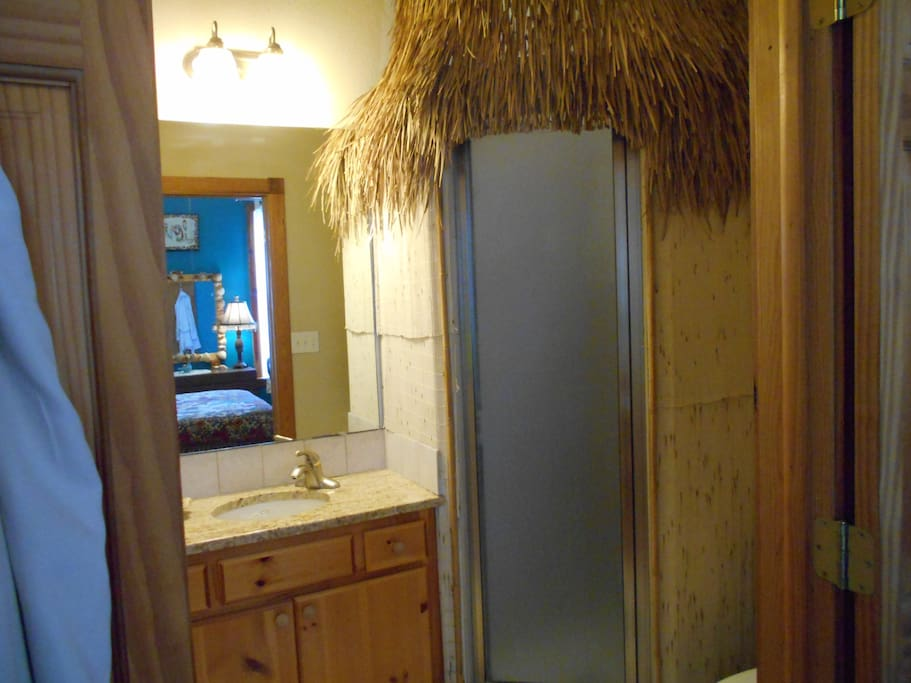 private bath for boho bedroom: sink, shower and commode