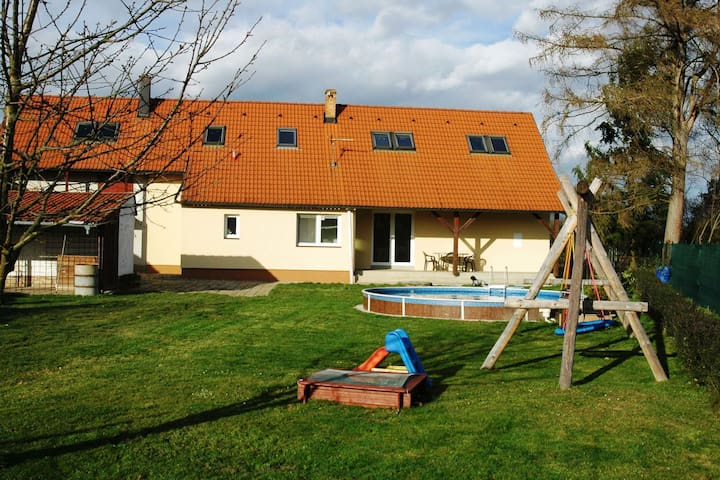 A detached house with the pool and then covered terrace in South Bohemia
