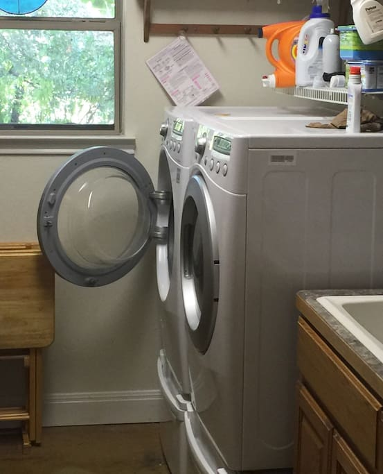 As you enter through your private side entrance, you'll find the Laundry room to the right.....