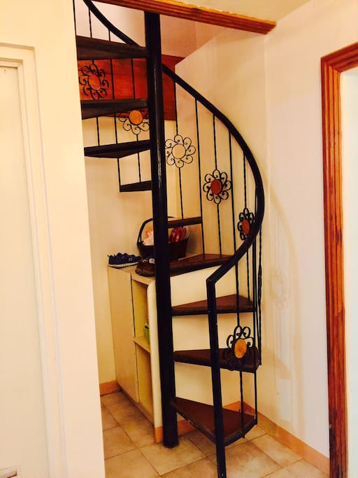 Spiral stairs going to the bedrooms