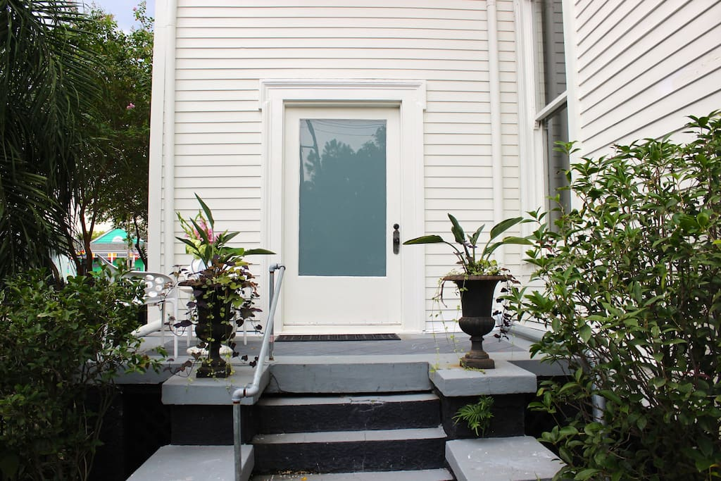 Front door of the studio with petite porch