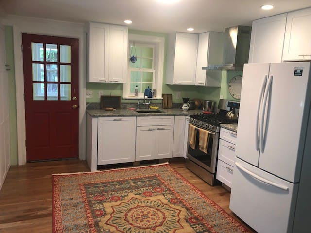 Kitchen with gas stove, dishwasher, refrigerator, granite counters and ample storage. Drip coffee maker, dishes and utensils, detergent, recycling and small appliances provided.