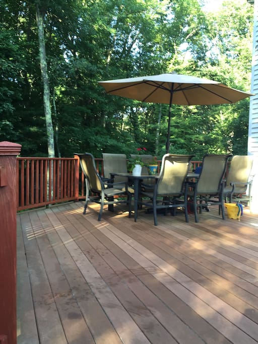 Large deck in a wooded setting