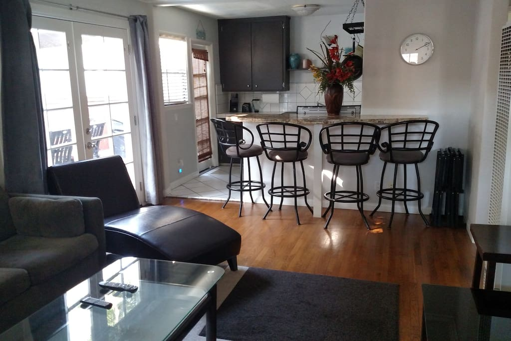 Living room and Bar counter with chairs.