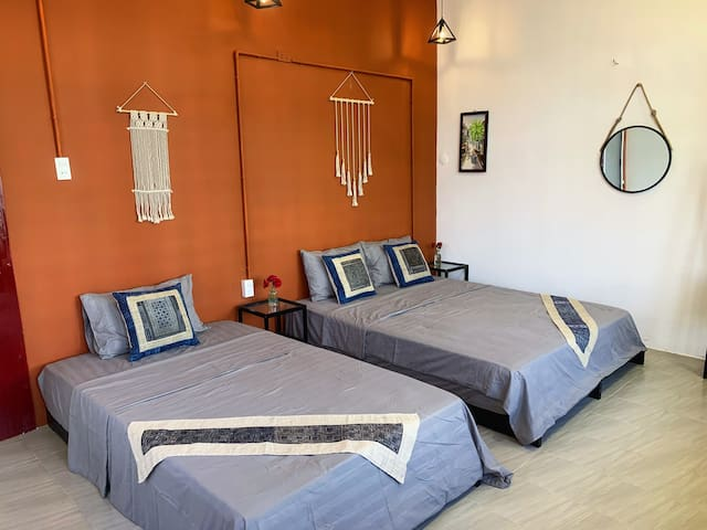This room has a balcony with overlooking street view. It's  is more than 16 square metres with 1 double bed (1m6 * 2m) and 1 single bed (1m2 * 2m).