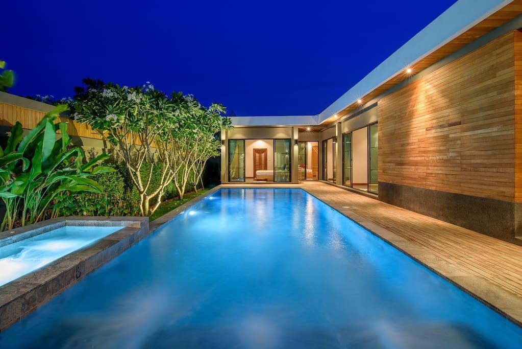 Unique style pool villa in night time