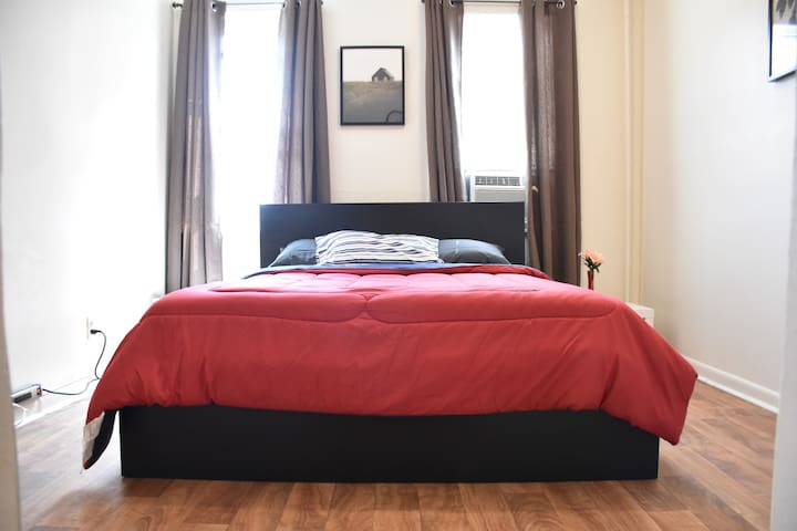 Queen size bed over looking 3rd Avenue