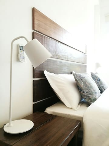 Second bedroom lamp and headboard detail.
