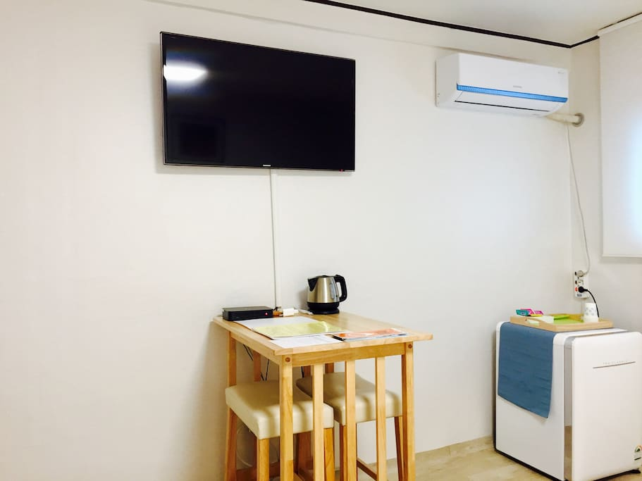 flat screen TV, mini fridge with a freezer, air conditioner available in the room!