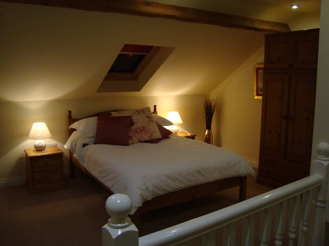 Gorgeous galleried bedroom upstairs with ensuite bathroom. Night time view