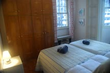 2nd bedroom with 2 single beds (different bedding- same room)