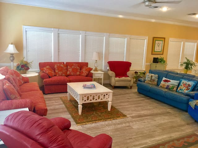 The main living area has new plank tile floors. The plan is open with views of the gulf from the kitchen, dining, living and main level balcony.