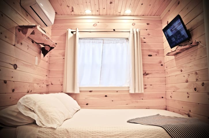 Luxurious sleeping area with all cotton bedding and Smart TV