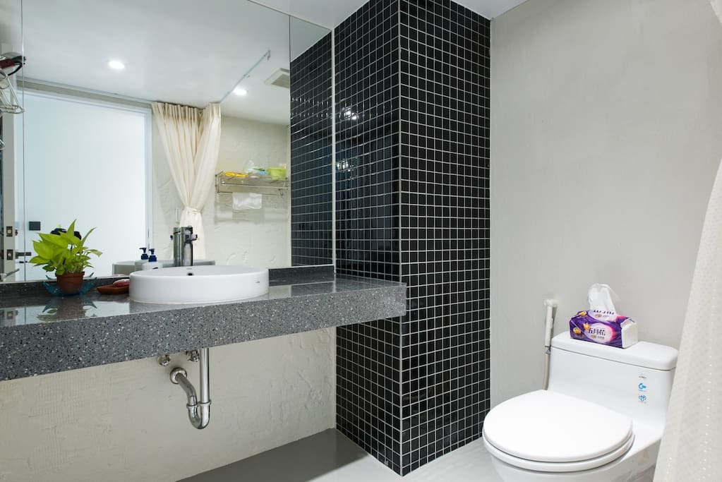 Bright and clean full bathroom with shower.