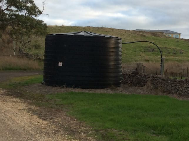 Our property entrance is immediately past this black tank.