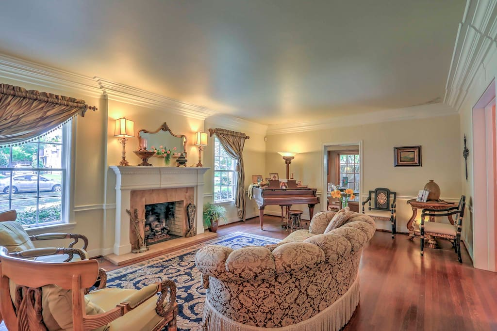 The expertly decorated home features hardwood floors and many pieces of original furniture.