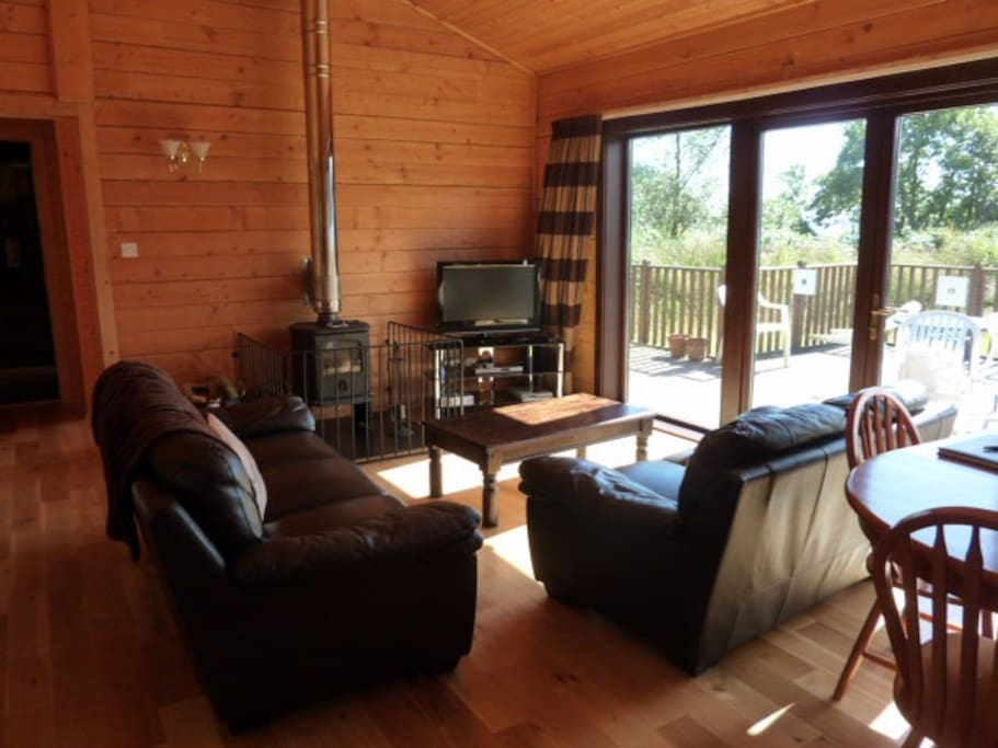 The spacious living room with log burner