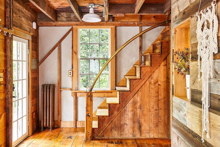 Entryway & staircase to the second floor. We love our brass pipe railing and all the different wood we have sneaked in the Barn.