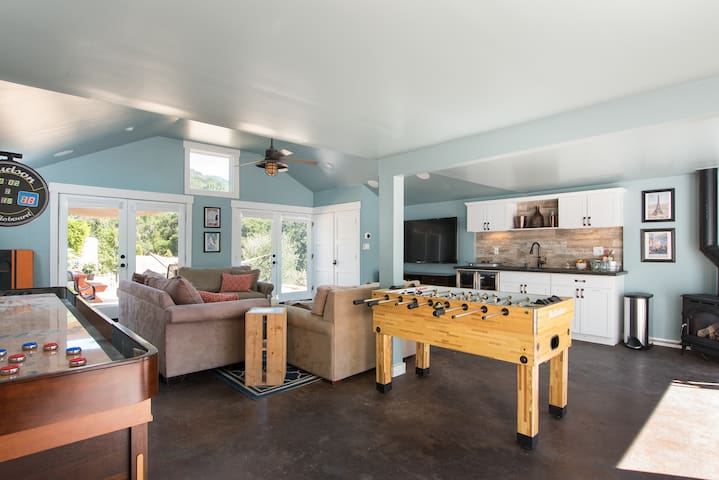 The game room is attached to the cottage.  Double french doors lead to a deck and backyard seating area. Enjoy your choice of games in this play space perfect for adults and kids alike!