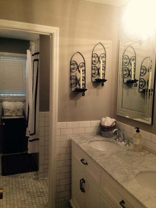 Enjoy a 'spa like' experience with carrara marble hexagon tile floors & marble counter tops with chrome lighting & accents throughout! Also subway tile chair rail on all walls -- to the ceiling above spacious shower! Offers  spacious tub!