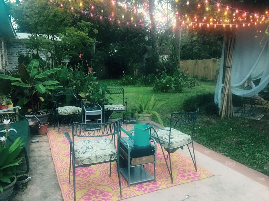 Luscious outdoor space with a variety of botanicals, patio and trellis space used for day and night time. This space is where all smoking is allowed. Use ashtray please.