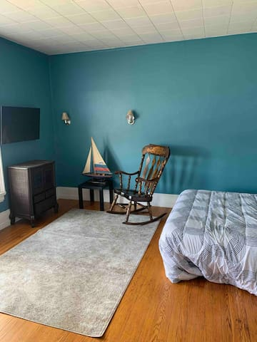 Bedroom with tv and view of Elmwood ave