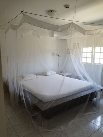 Our guest room (children room is also downstairs with a wooden treehouse bed for two or three kids)